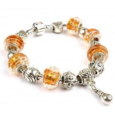 Браслет в стилі Пандора з намистинами з муранського скла медово-бурштинового кольору